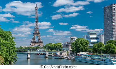 Eiffel tower at the river Seine timelapse from bridge in...