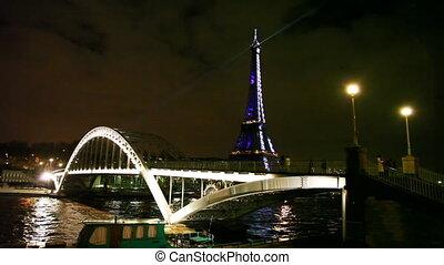 Eiffel Tower, Debilly Footbridge and river Seine in Paris -...