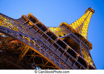 Eiffel Tower from the bottom at the dusk. Paris, France