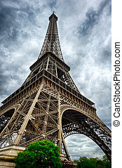Eiffel Tower in Paris at cloudy summer day