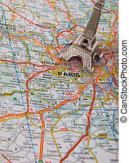 Eiffel Tower on a map of Paris, short focus
