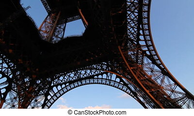 Wideangle handheld pan shot of the Eiffel Tower. Paris, France.