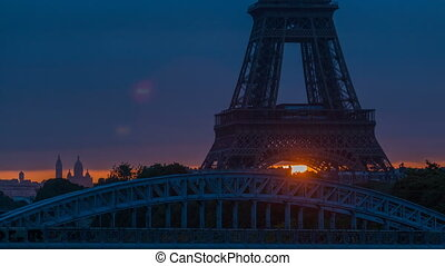 Eiffel Tower sunrise timelapse with boats on Seine river and...