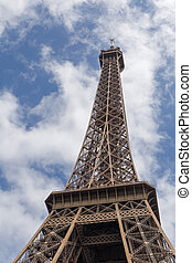 Eiffel toweragainst blue sky with clouds