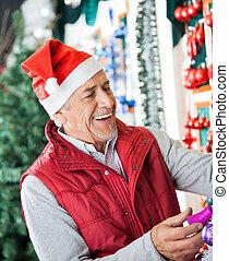 eigenaar, in, kerstmuts, werken aan, kerstmis, winkel