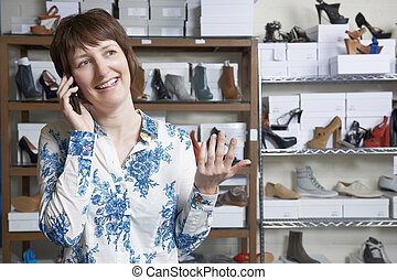 eigenaar, telefoon, schoenenwinkel