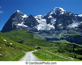 Eiger and Monch mountains in Switzerland Alps - Panorama...