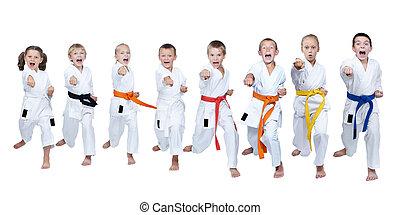 Eight athletes in karategi hit blow