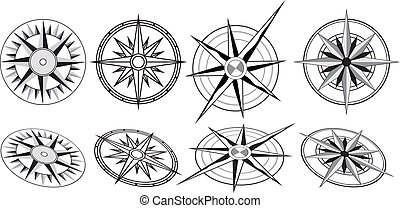 Eight Black and White Compasses - Four different compasses,...