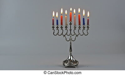 Eight candles in hanukkiah are burning on the seventh day of...