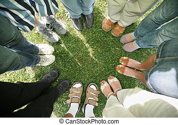 Eight friends stand in a circle