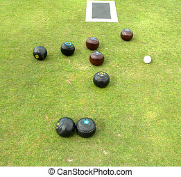 Eight lawn bowls - eight lawn bowls with jack and mat on ...