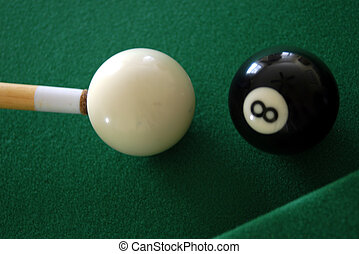 eight pall - close view of the eight ball and cue ball about...