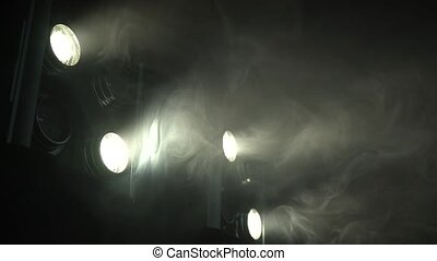 Eight spotlights flicker in a smoky room - Eight large ...