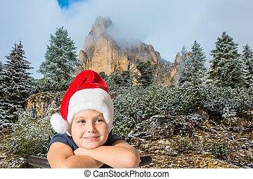 Eight-year boy in Santa Claus hat