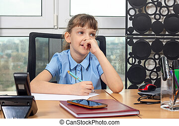 Eight-year-old girl thoughtful at the table in the office