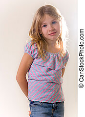 eight year old - cute little eight year old girl standing on...