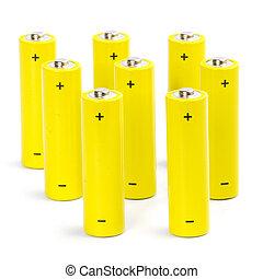 eight yellow alkaline batteries isolated on white backgroun
