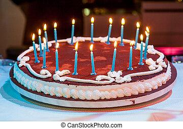 Eighteen years birthday. Chocolate Cake with burning candle