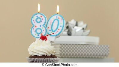 Eighty 80 candle in cupcake pastel background - Number...