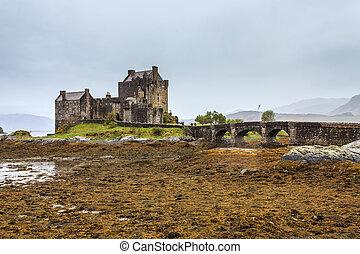 Eilan Donan castle at low water in Scotland