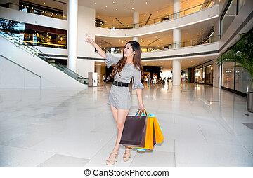 einkaufszentrum, frau- einkaufen, junger