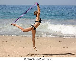 ejercitar, en la playa