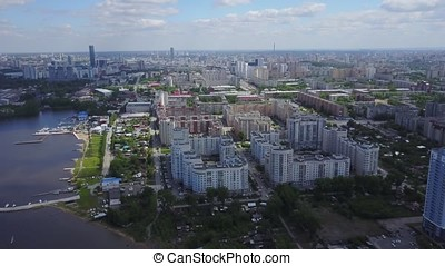 Ekaterinburg rooftop view panorama at sunset with urban architectures and River. Magnificence of Ekaterinburg City, Aerial View From Helicopter. Beautiful sleeping district aerial view