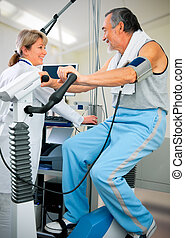 EKG test - Patient is being observed by doctor - EKG test