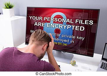 ekran, zmartwiony, komputer, człowiek, ransomware