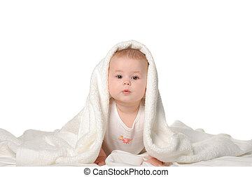 el, bebé, debajo, un, towel., edad, de, 8, months., él, es, aislado, en, un, fondo blanco