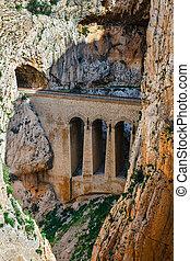 El Caminito del Rey with train stone bridge in Malaga, Spain.