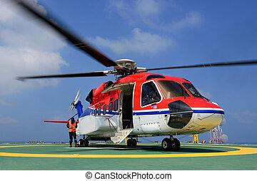 el, costa afuera, helicóptero, es, aterrizaje, a, embarcar, pasajero, en, plataforma petrolera, plataforma