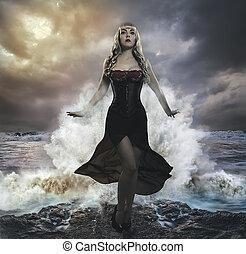 el, fuerzas naturaleza, rubio, mujer, sobre las rocas, con, el, mar, trapo