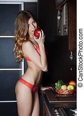 el, mujer, en, ropa interior, con, un, cesta de la fruta, en, cocina