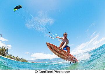 el practicar surf de la cometa
