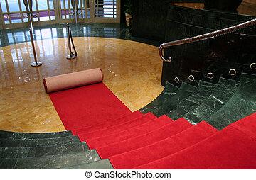 el rodar hacia fuera, alfombra roja