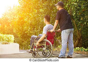 el suyo, sentado, sílla de ruedas, joven, hermano, hombre