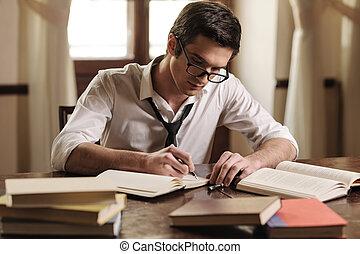 el suyo, work., sentado, escritor, joven, escritura, sketchpad, algo, tabla, guapo