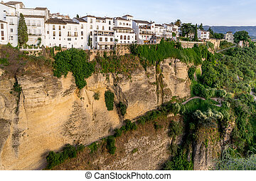 Buildings on the edge of the cliff that overlooks the El Tajo ravine in Ronda Spain.