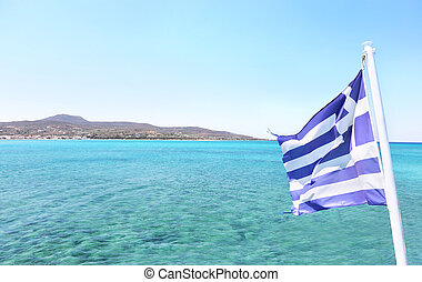 Elafonisos island as seen from the ship and the greek flag waving - Lakonia Peloponnese Greece