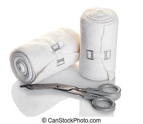 elastic bandage and scissors