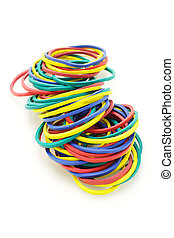 Colorful elastic rubber bands on white background