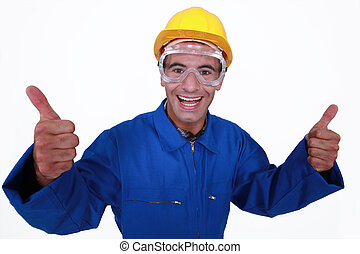 Elated tradesman giving two thumb's up
