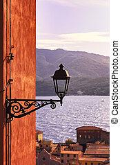Elba, Portoferraio street lamp view on the sea on sunset. Tuscany, Italy