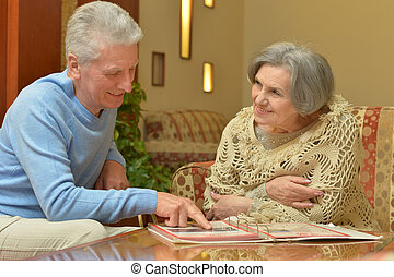 Elder couple sitting at a table at home