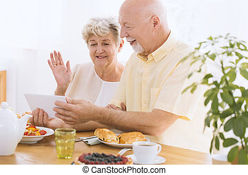Elder couple watching photos