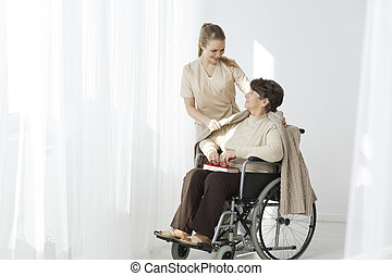 Elder lady in a wheelchair