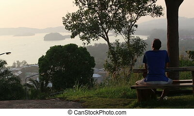 elder man look at sunset in sea