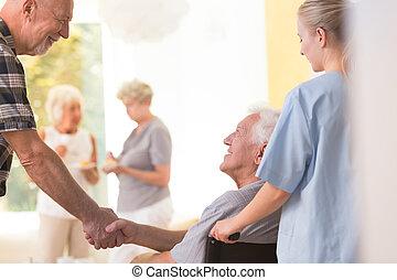 Elder men shaking hands